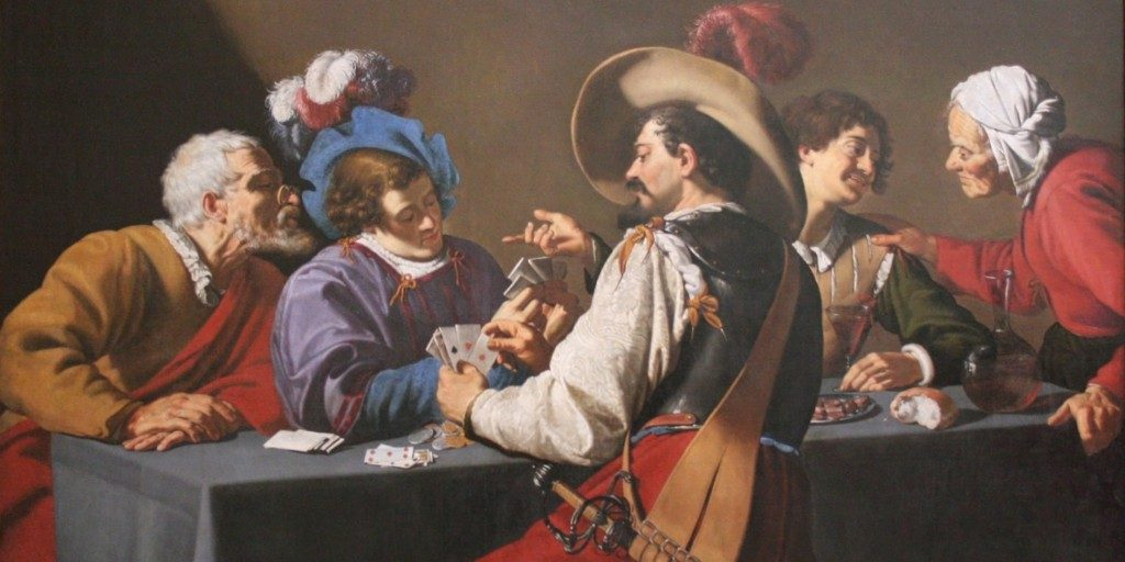 an image showing people playing cards